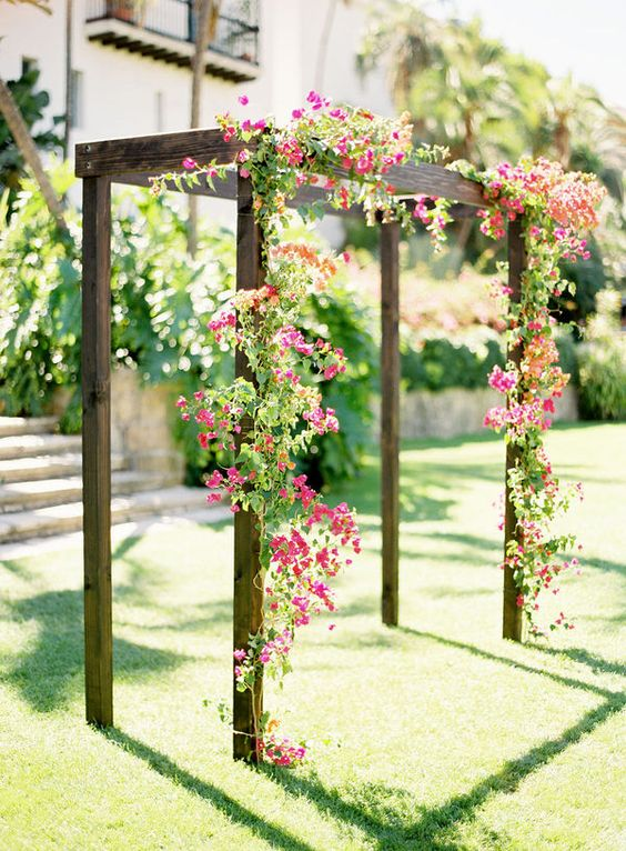 wooden arbor decorated with bold flowers