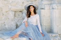 35 grey blue skirt and a white lace top with long sleeves