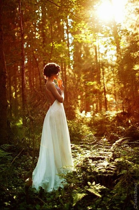 woodland bride standing in the sunlight