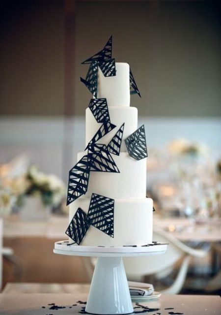 chic modern white cake decorated with black geometric details