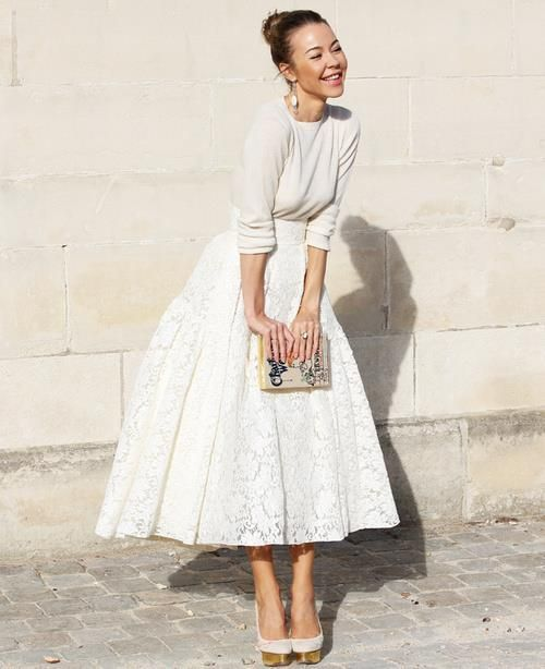 bridal separate with a lace midi skirt and a neutral sweater, a whimsy clutch and heels