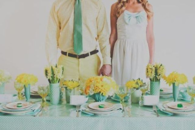 mint reception table with mint vases and tableware, bold yellow flowers