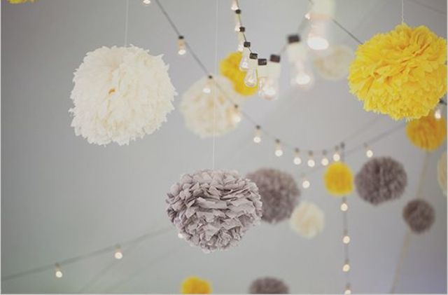 yellow, grey and ivory pompoms for wedding decor