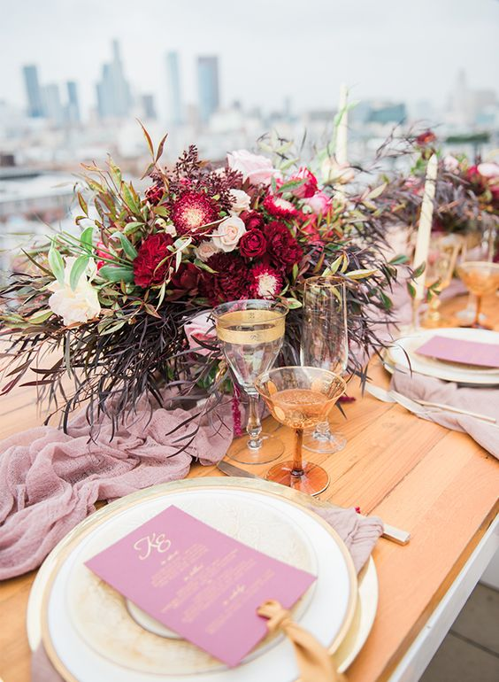 boho rooftop wedding decor in pink and burgundy