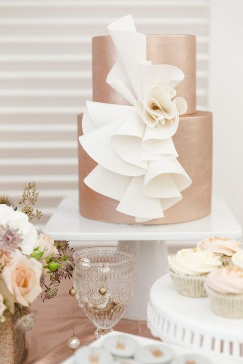 copper wedding cake with wwhite decor