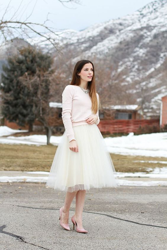 white tutu skirt, a blush sweater and heels, a statement necklace