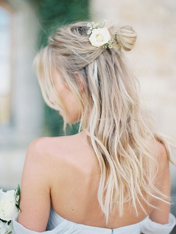 messy half-down hairstyle with fresh flowers