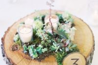 39 wood slice with moss and flowers, a small table number