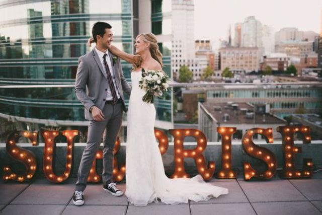 invite everyone to a rooftop for a surprise wedding