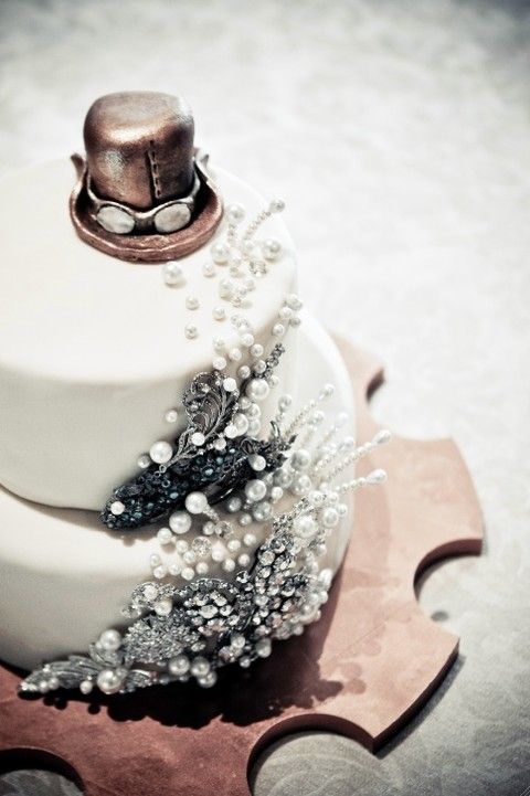 original wedding cake with pearls and a google glasses hat