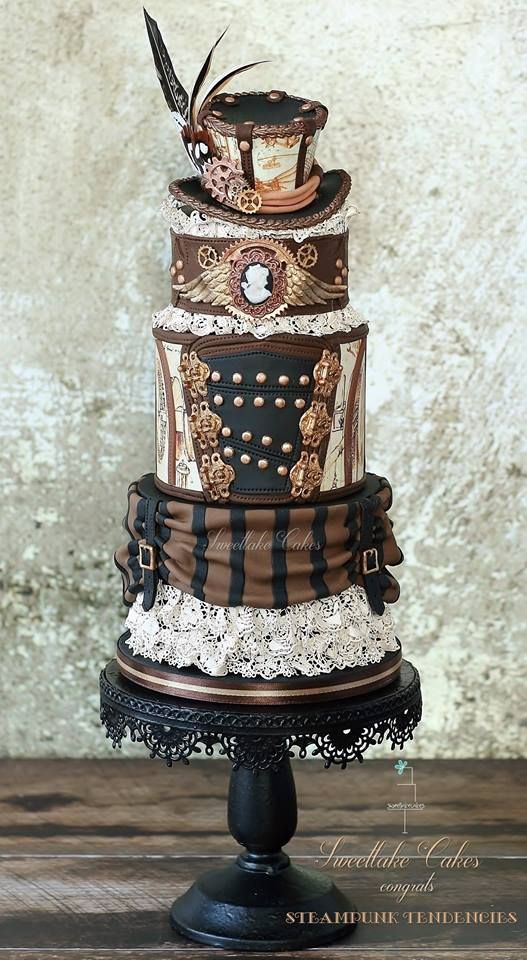 stylish steampunk wedding cake topped with a hat