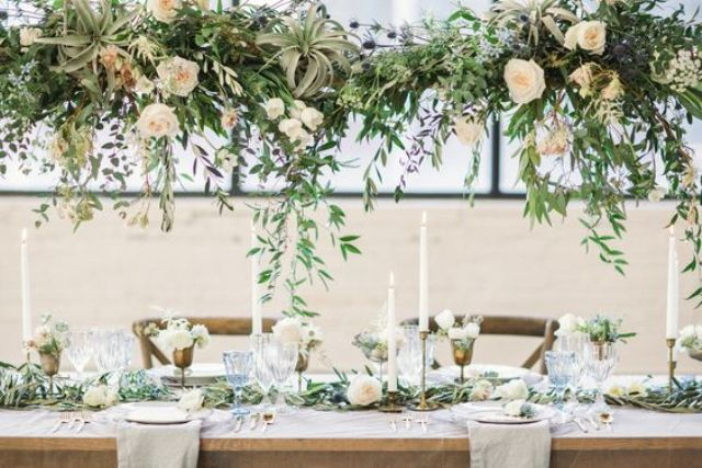 air plants, greenery and roses chandliers over the reception