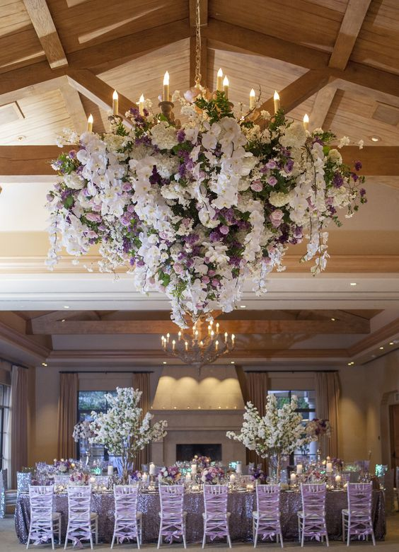 An Elegant Fl Chandelier Was Embellished With Lush White And Lavender Flowers