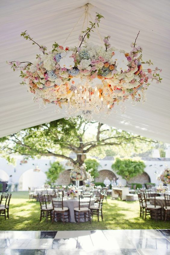 29 gorgeous wedding floral chandeliers that will blow your mind beautiful floral chandelier in pastel shades with crystal pendants for a spring wedding aloadofball Gallery