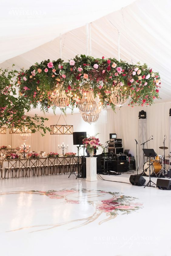 Bold Flower Chandeliers With Usual Crystal Ones For Accentuating A Floor