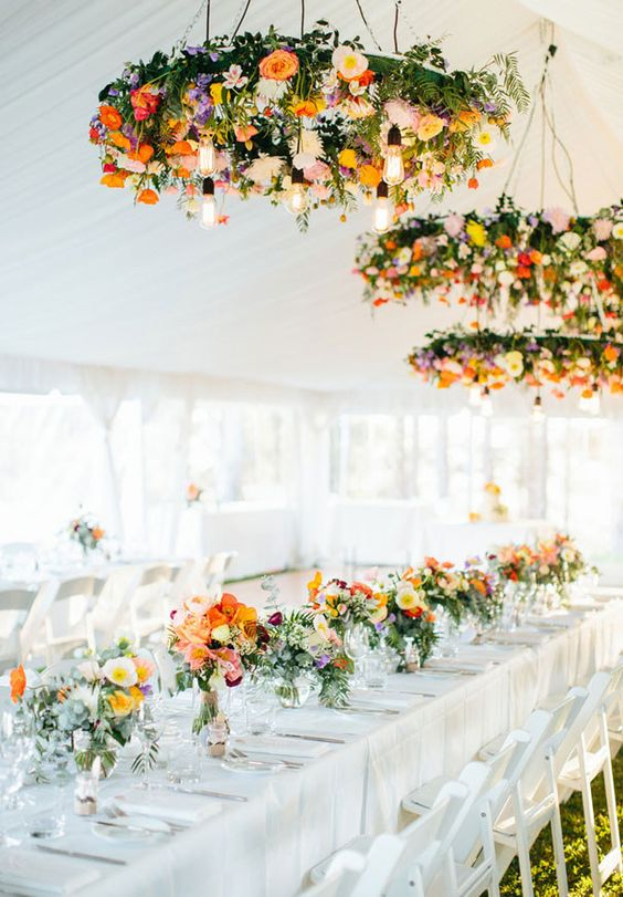 colorful lush chandeliers of various flowers and with bulbs create a focal point