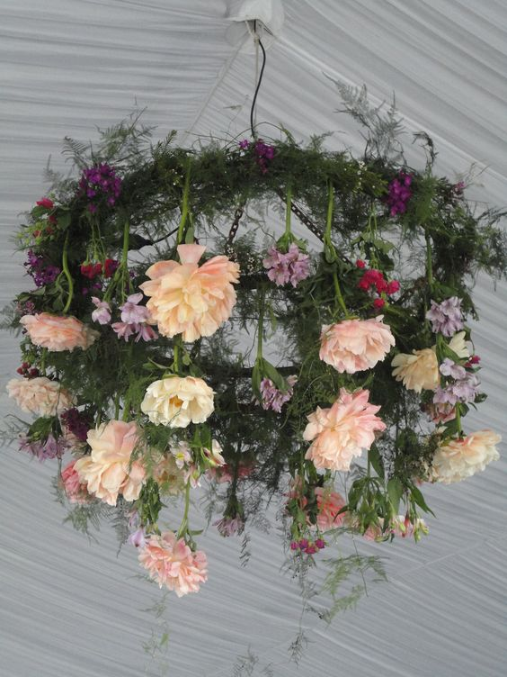 fern and flower chandelier for a rustic wedding