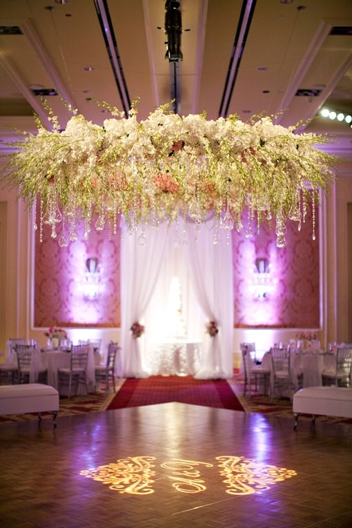29 gorgeous wedding floral chandeliers that will blow your mind white flower chandelier with crystals for highlighting the dance floor aloadofball Gallery