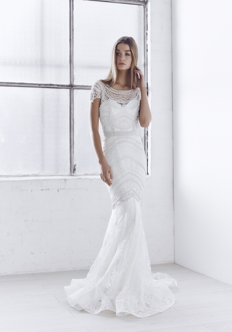 A figure flattering trumpet skirt and elegant illusion neckline with a distinctive, geometrical hand embellishment make the Florence both unique and chic