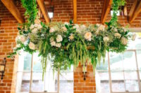 02 Lush floral and greenery hangings with blush peonies decorated the whole venue and created a refined atmosphere