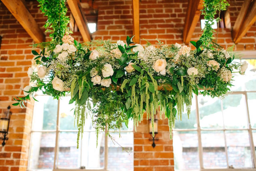 Lush floral and greenery hangings with blush peonies decorated the whole venue and created a refined atmosphere