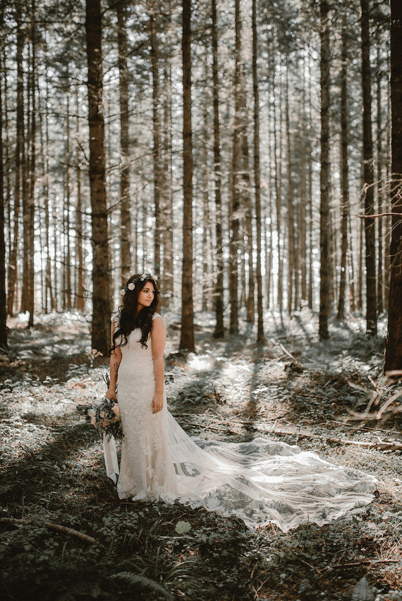 The bride was wearing an ivory lace keyhole back dress with a train and a floral crown
