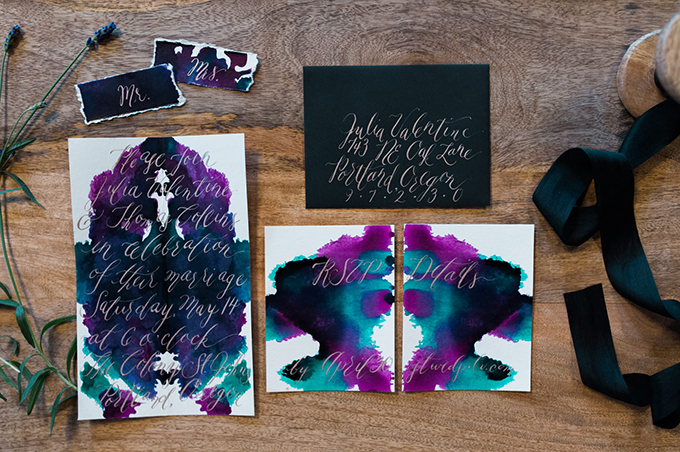 The invitations were inspired by Rorschach Inkblot Test and done in purple, blue and black