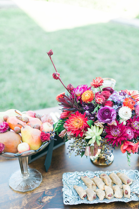 The shower decor was fall and boho, with colorful florals, fruit and berries
