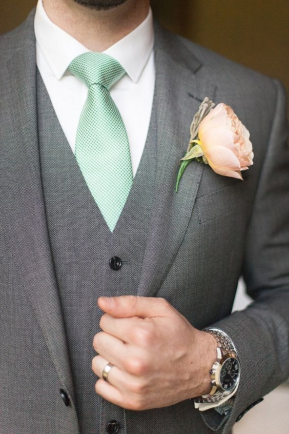 a peach boutonniere and a mint tie for the groom