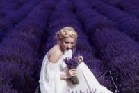 02 bride in a cold shoulder wedding dress with a lavender crown and bouquet in a lavender field