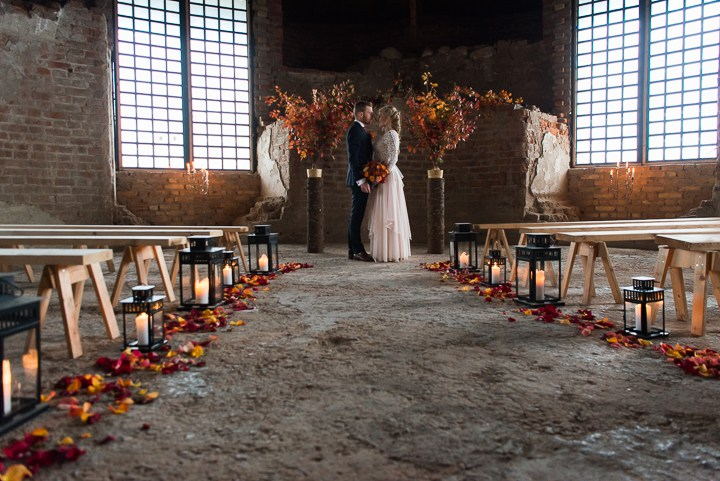 the venue was a bit industrial but still decorated with fall branches and flowers, and also candle lanterns