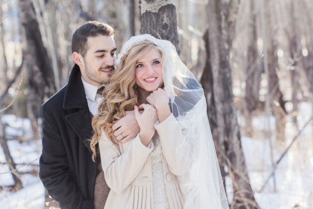She wore a neutral short coat to feel cozy and a veil for a romantic look
