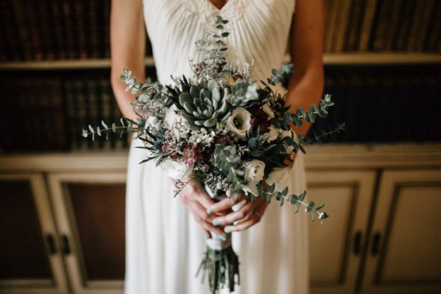 The bridal bouquet was made of white flowers, eucalyptus and succulents