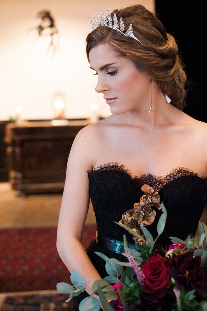 The bridal look was stunning, with a black lace dress, a silver crown and earrings, a bold bouquet