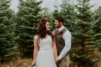 03 The bride was earing an ivory V-neck wedding dress and a bejeweled sash, and the groom rocked a vintage look wit pants and a vest