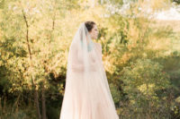 03 The bride was wearing a gorgeous wedding gown in blush and a matching veil, both with texture