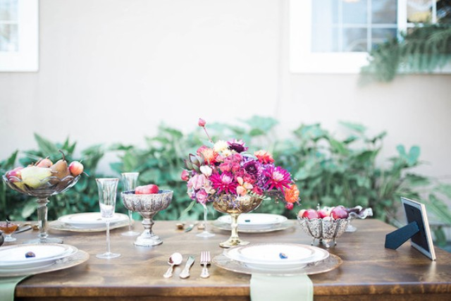 The tablescape was a simple one, with a rustic wooden table, bold flowers and fruit, exquiiste silver tableware