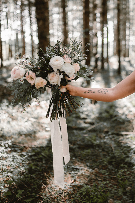This bridal bouquet looks textural and very forest-like, and I love blush roses