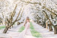 03 a beautiful blush wedding dress echoes with the blush trees around