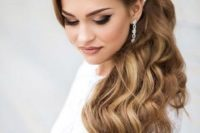 03 accentuate your curly hair with a hairpiece