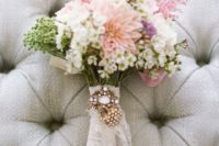 03 attach some grandmother's brooches to your bouquet wrap