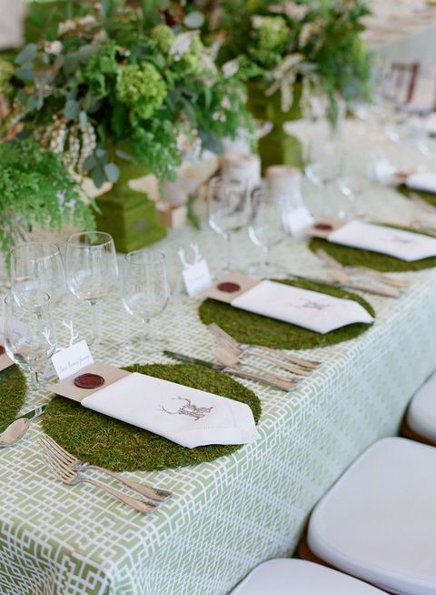 moss placemats, a geometric green and white tablecloth