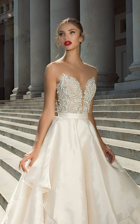strapless deep plunging sweetheart neckline and a heavily embellished bodice