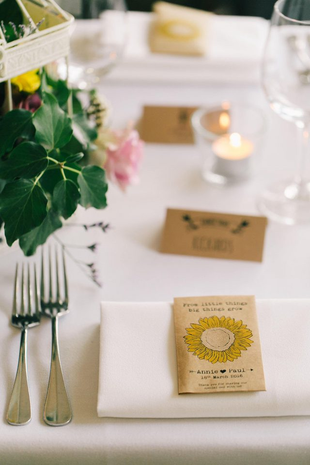 Antique-styled escort cards were also with sunflowers