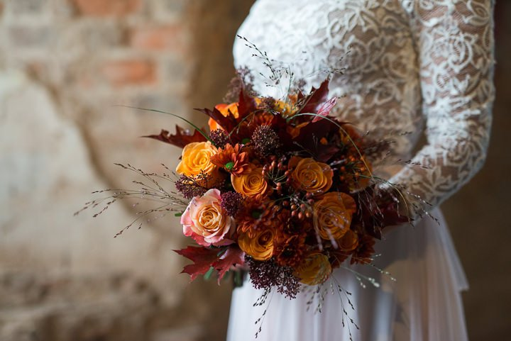 Her bouquet was fall-colored, with ornage roses and burgundy leaves