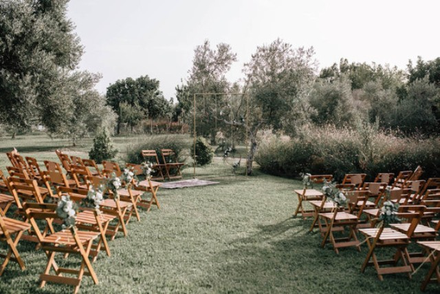 The ceremony spot was an open and airy space with rustic chairs for the guests