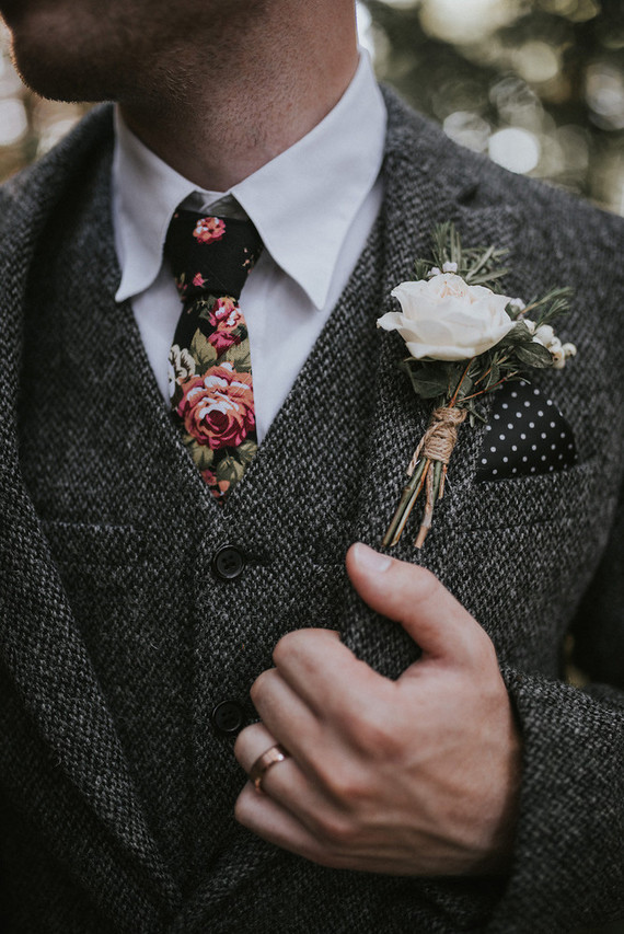 The groom was wearing a tweed suit and a floral tie, his look was rustic-inspired and woodland