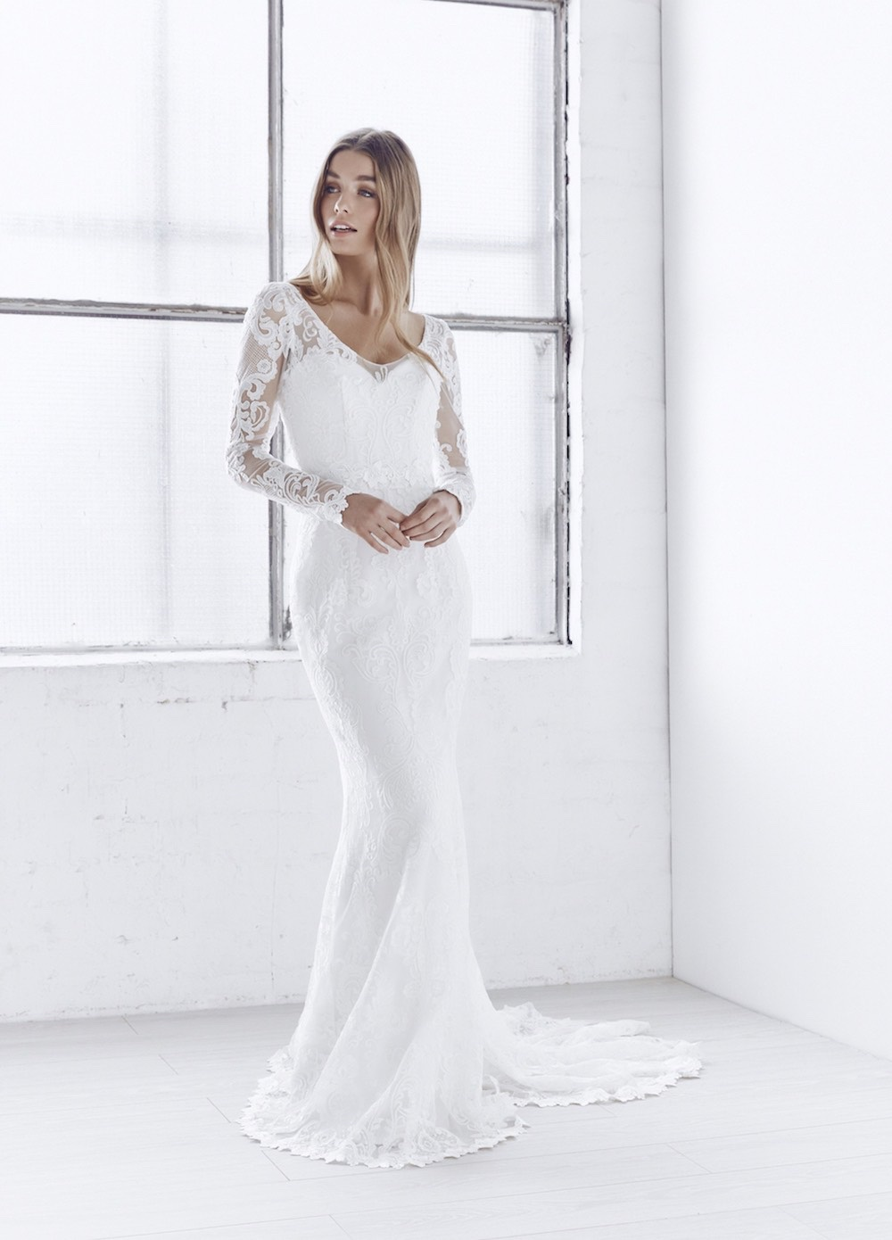 With a beautiful, botanical inspired embroidered lace and sheer long sleeves, the India is opulent and bohemian, calling for bare feet, tousled hair and an adventurous spirit