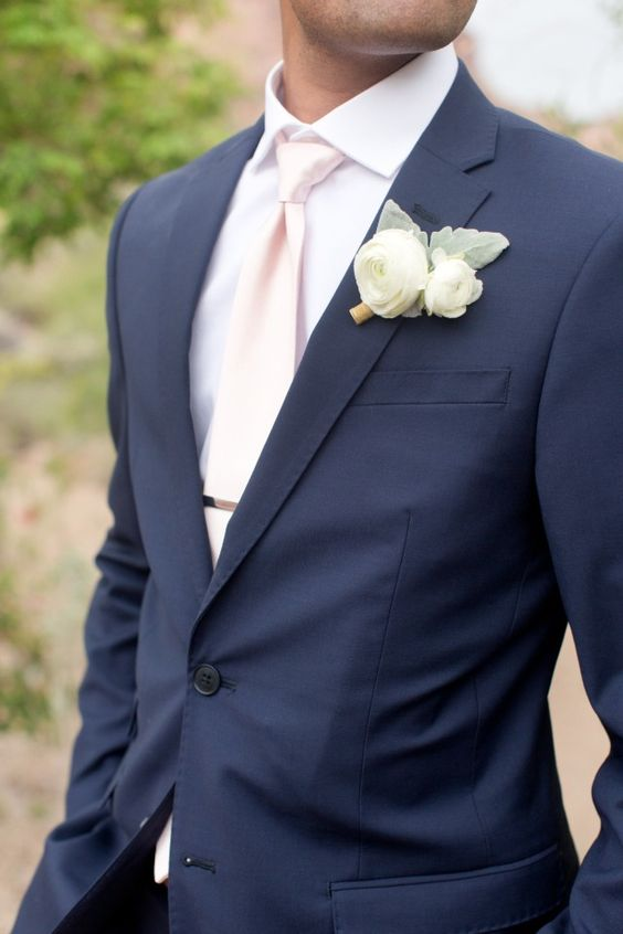 a navy suit and a blush tie for a stylish groom look