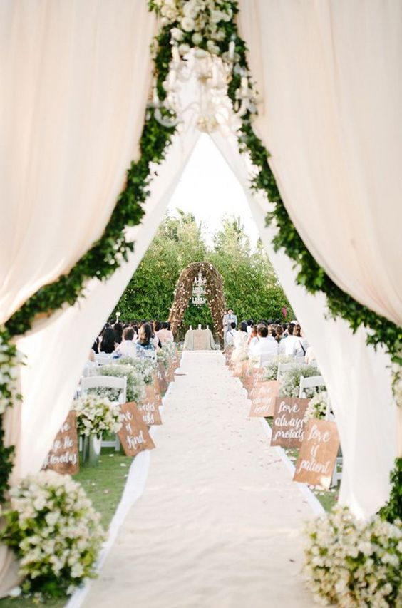 airy fabric, greenery and ivory flowers for a spring garden wedding